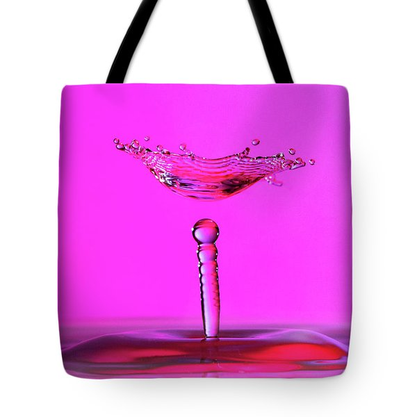 Tote Bag featuring the photograph Hovering Collision And Beaded Column In Pink by SR Green