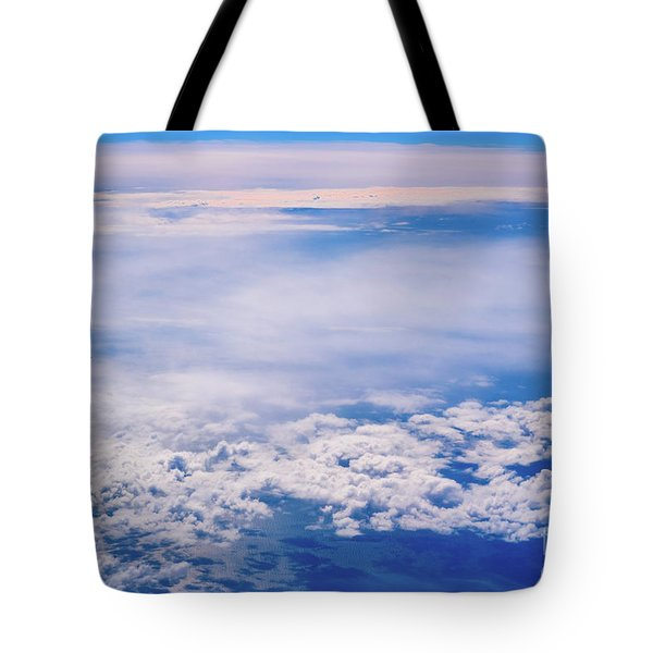 Intense Blue Sky With White Clouds And Plane Crossing It, Seen From Above In Another Plane. Tote Bag
