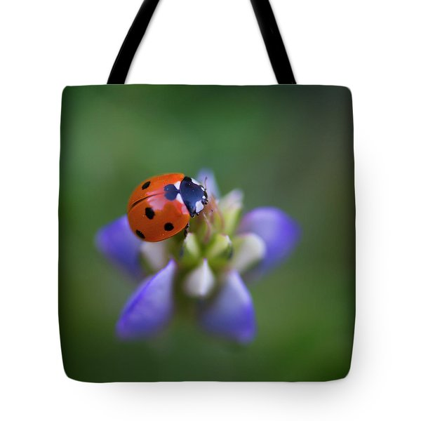 Tote Bag featuring the photograph Lady Bug by John Rodrigues