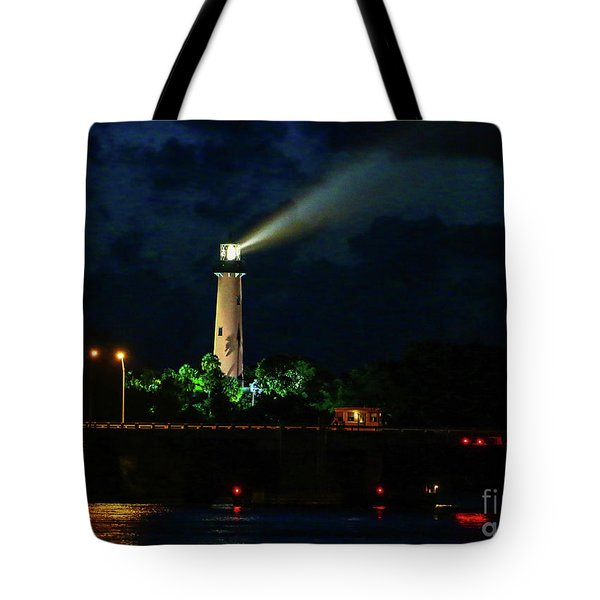 Tote Bag featuring the photograph Lighthouse Lightbeam by Tom Claud