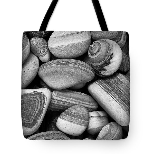 Tote Bag featuring the photograph Lined Rocks And Shell by John Rodrigues