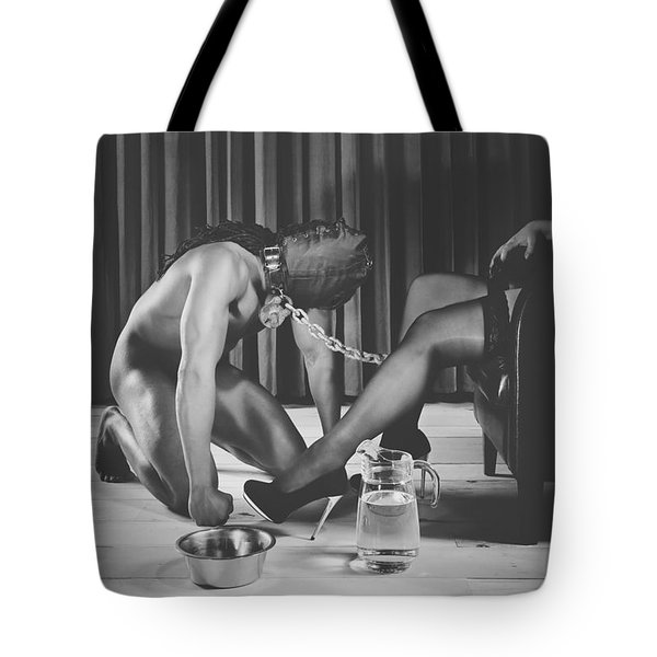 Man With Masked Face On His Knees In Front Of His Mistress Tote Bag