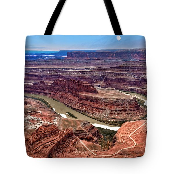Tote Bag featuring the photograph Moon Over Deadhorse Point by Andy Crawford