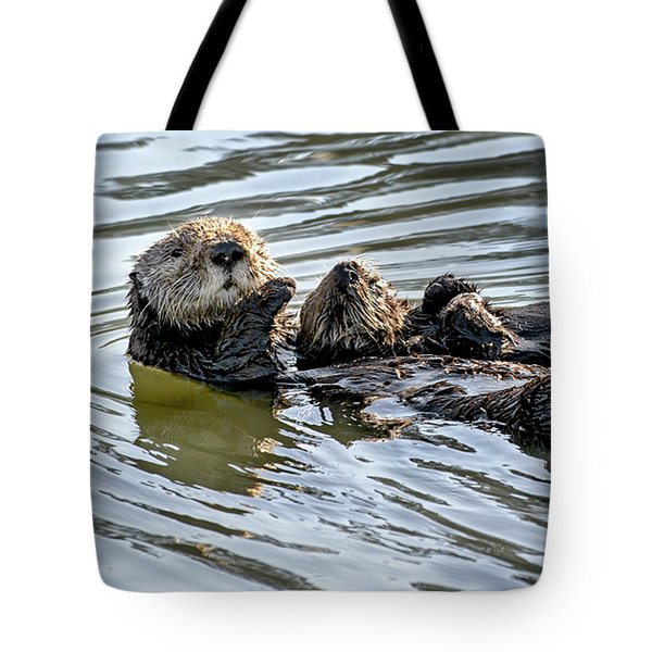 Mother Sea Otter Relaxing With Baby Tote Bag