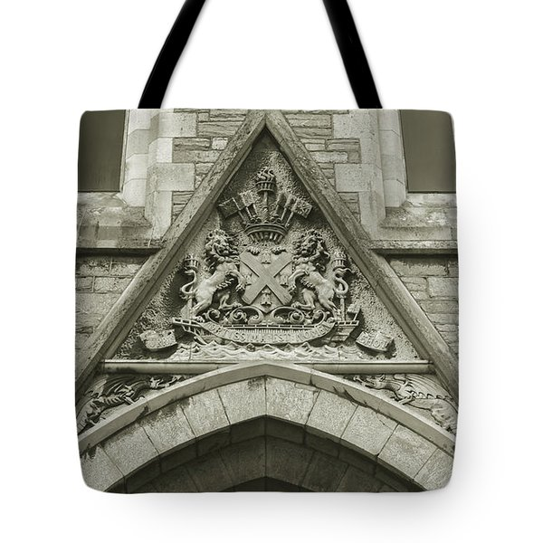 Tote Bag featuring the photograph Old Coat Of Arms On Plymouth Guildhall by Jacek Wojnarowski