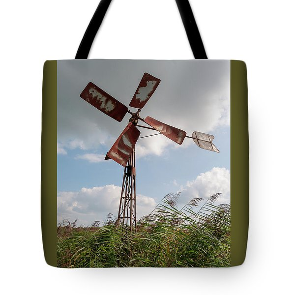Tote Bag featuring the photograph Old Rusty Windmill. by Anjo Ten Kate