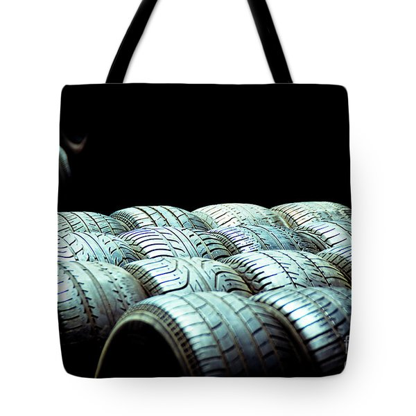 Old Tires And Racing Wheels Stacked In The Sun Tote Bag