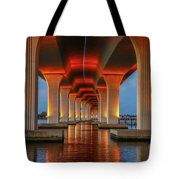 Tote Bag featuring the photograph Orange Light Bridge Reflection by Tom Claud