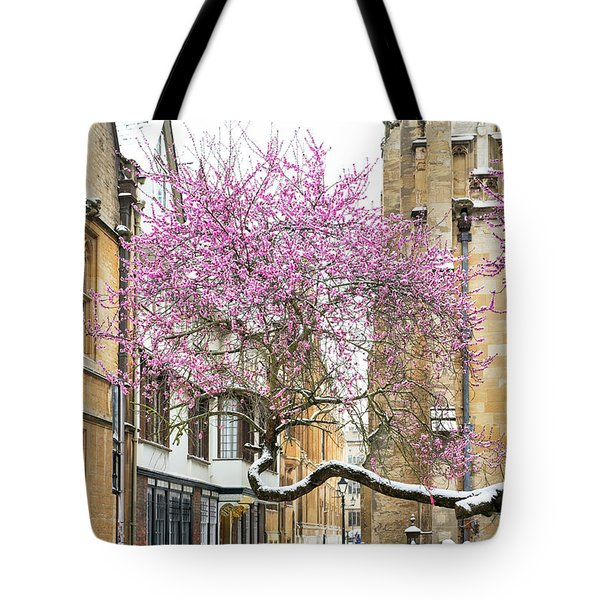 Tote Bag featuring the photograph Oxford Almond Tree Blossom In The Snow by Tim Gainey