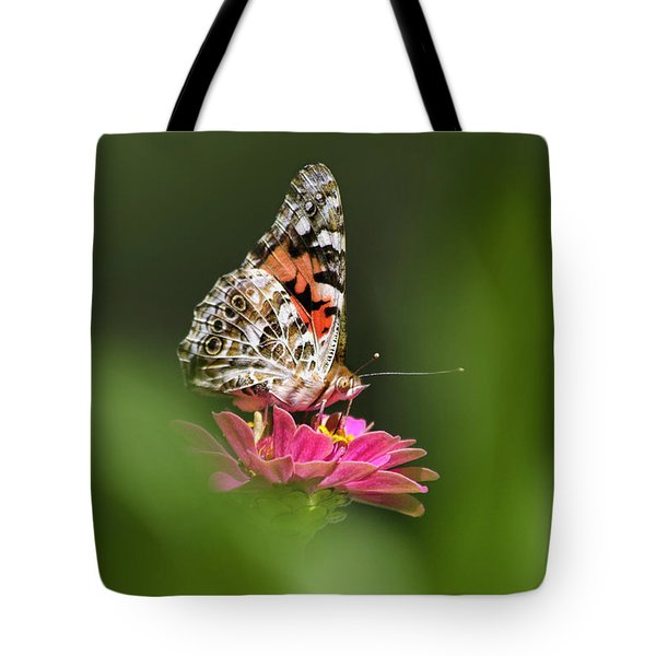 Tote Bag featuring the photograph Painted Lady Butterfly At Rest by Christina Rollo