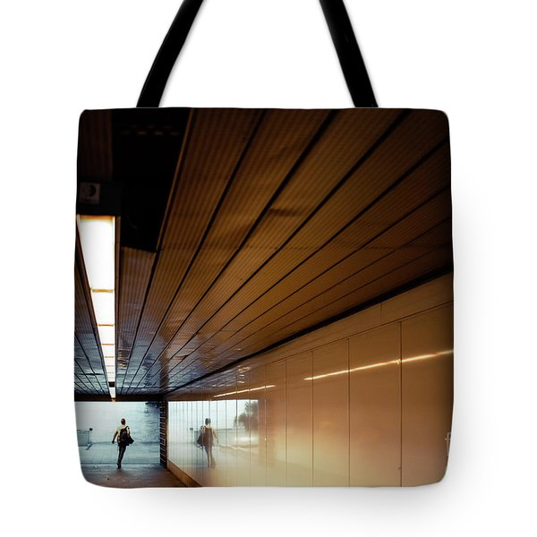 Passengers In A Hurry At The End Of A Tunnel At The Entrance To The Metro Station. Tote Bag