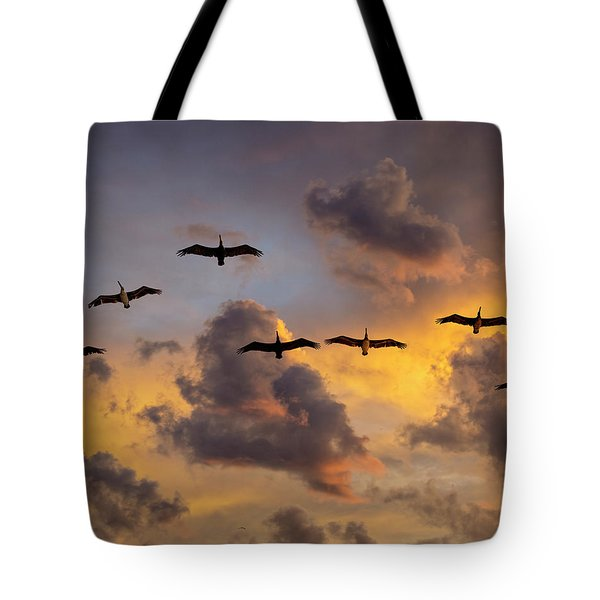 Tote Bag featuring the photograph Pelicans In The Clouds by John Rodrigues