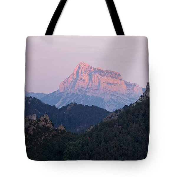 Tote Bag featuring the photograph Pena Montanesa Glowing Red by Stephen Taylor