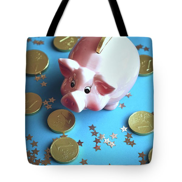 Piggy Bank On The Background With The  Chocoladen Coins Tote Bag