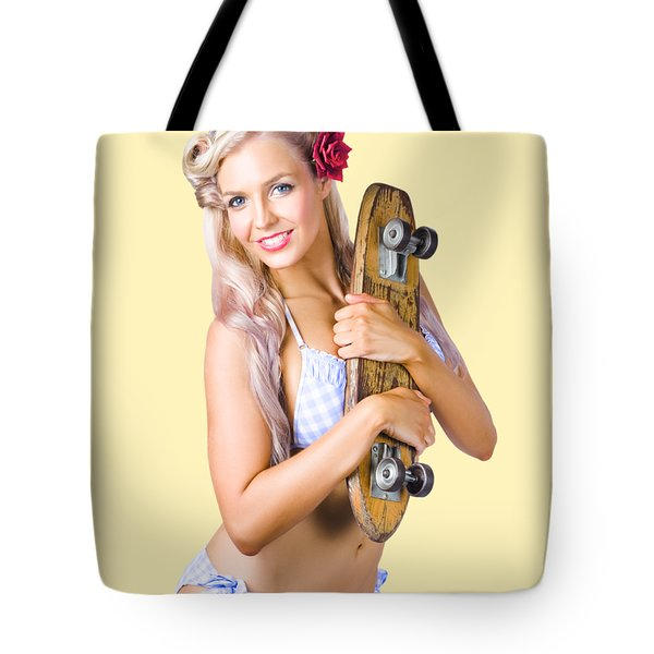 Tote Bag featuring the photograph Pinup Woman In Bikini Holding Skateboard by Jorgo Photography - Wall Art Gallery