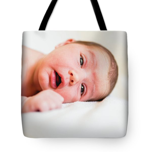 Portrait Of Newborn Baby Girl Feels Safe And Awake To A New Life. Tote Bag