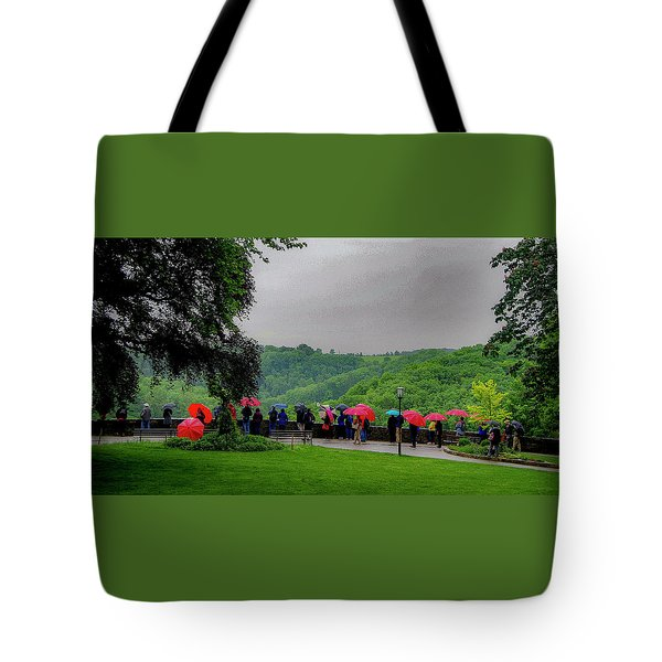 Tote Bag featuring the photograph Rainy Day Umbrellas by Phyllis Spoor