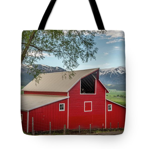 Tote Bag featuring the photograph Red Barn By The Road by Matthew Irvin