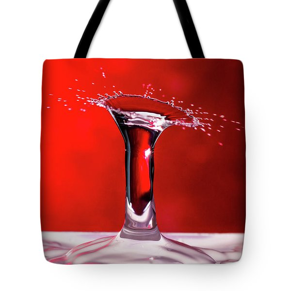 Tote Bag featuring the photograph Red Column Water Drop Collision by SR Green