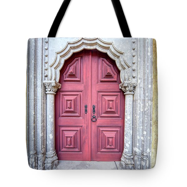 Tote Bag featuring the photograph Red Medieval Door by David Letts