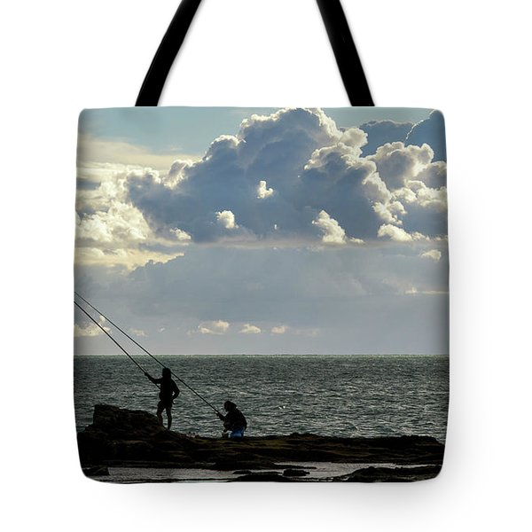 Tote Bag featuring the photograph Rock Fishing by Pablo Avanzini