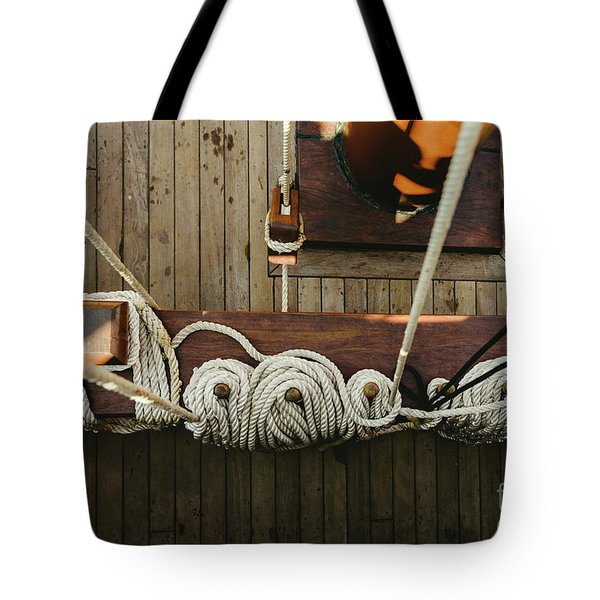 Ropes To Hold The Sails Of An Old Sailboat Rolled. Tote Bag