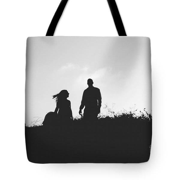 Silhouette Of Couple In Love With Wedding Couple On Top Of A Hil Tote Bag