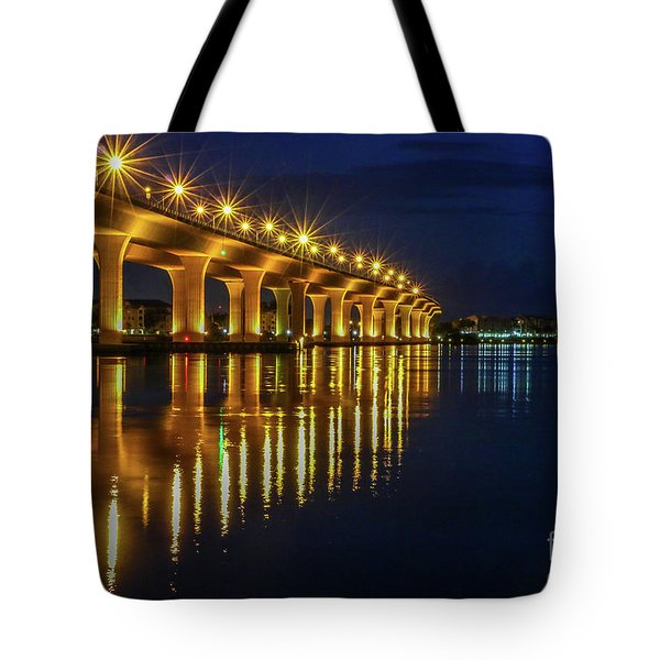 Tote Bag featuring the photograph Starburst Bridge Reflection by Tom Claud