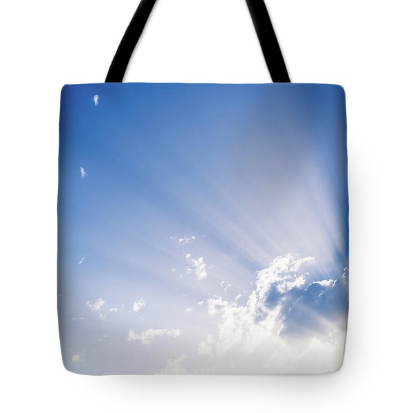 Sunbeams Rising From A Large Cloud In Intense Blue Sky On A Summer Afternoon Tote Bag