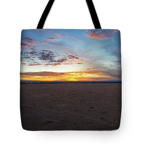 Tote Bag featuring the photograph Sunrise Over The Mara by Thomas Kallmeyer