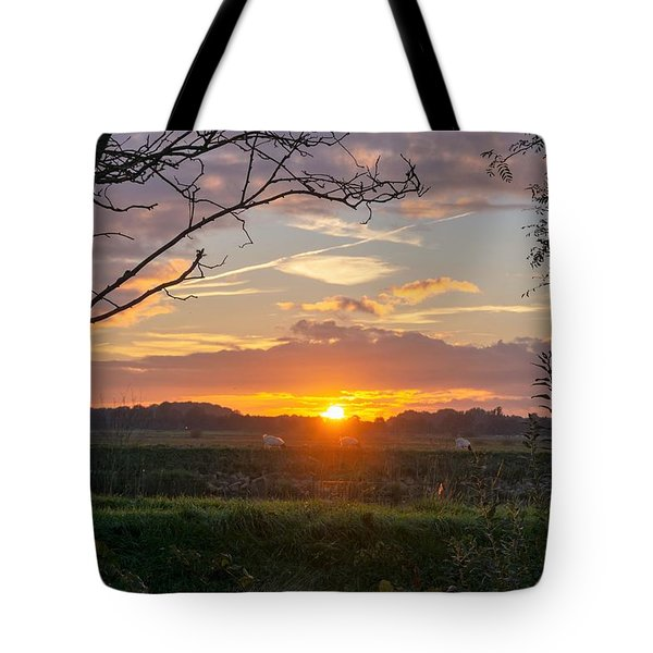 Tote Bag featuring the photograph Sunset by Anjo Ten Kate