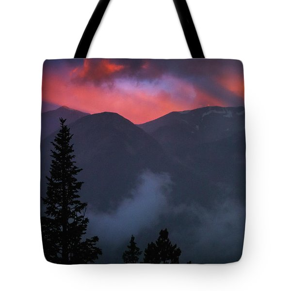 Tote Bag featuring the photograph Sunset Storms Over The Rockies by John De Bord