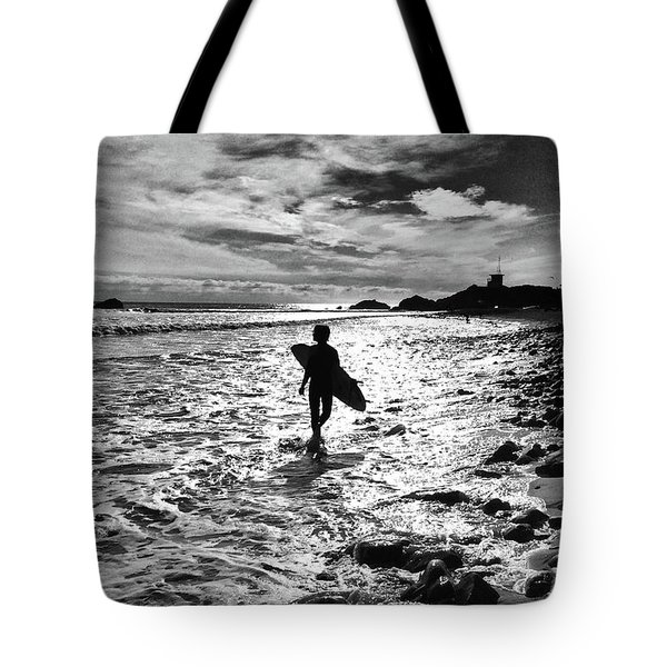 Tote Bag featuring the photograph Surfer Silhouette by John Rodrigues