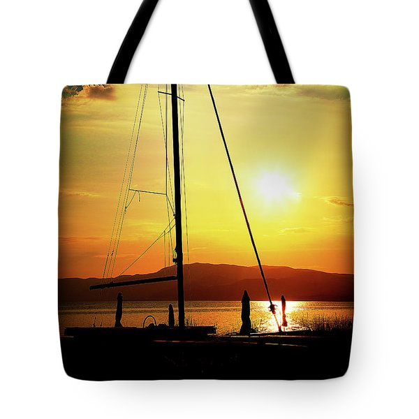 Tote Bag featuring the photograph the Boat and the Sky by Milena Ilieva