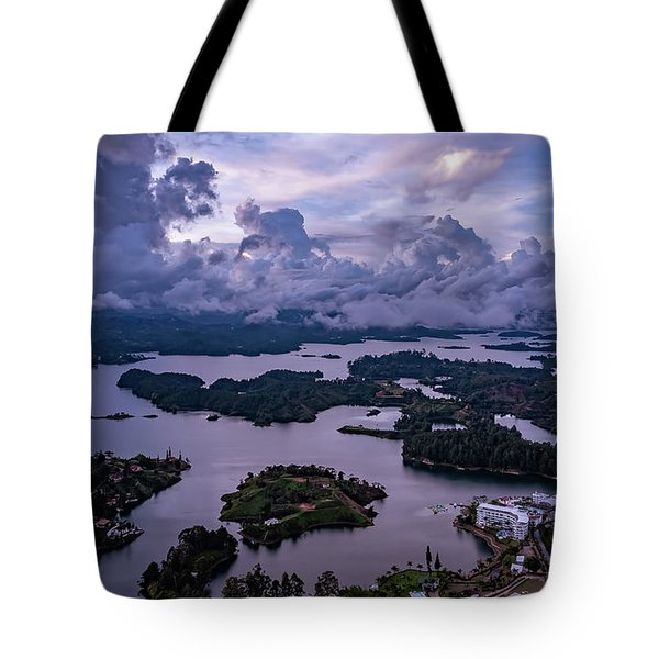 Tote Bag featuring the photograph The Clouds At Penol by Francisco Gomez