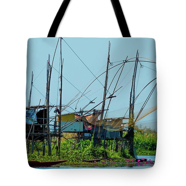 Tote Bag featuring the photograph The Fisherman by Jeremy Holton