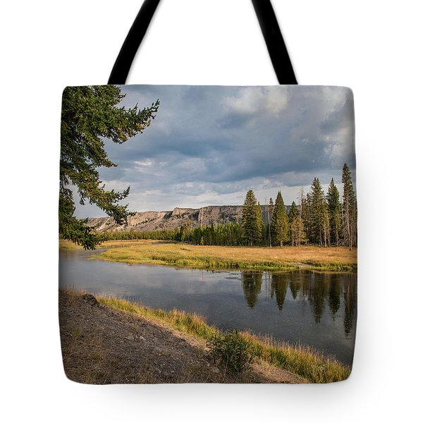 Tote Bag featuring the photograph The Madison River At West Yellowstone by Lon Dittrick