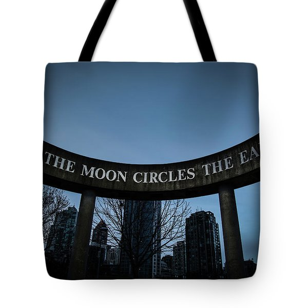 Tote Bag featuring the photograph The Moon Circle by Juan Contreras