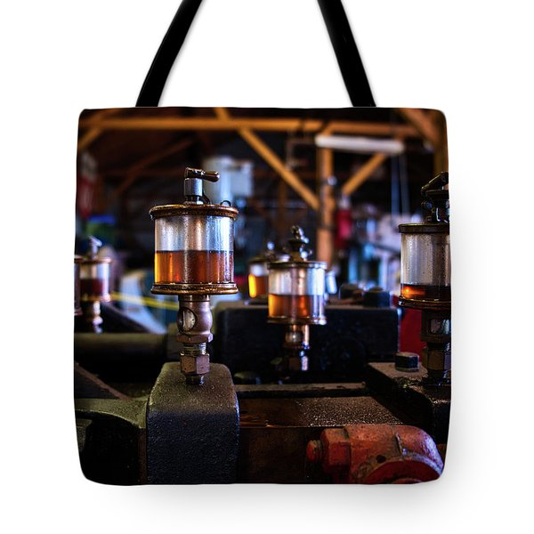 Tote Bag featuring the photograph The Power Of Oil by Mark Dodd