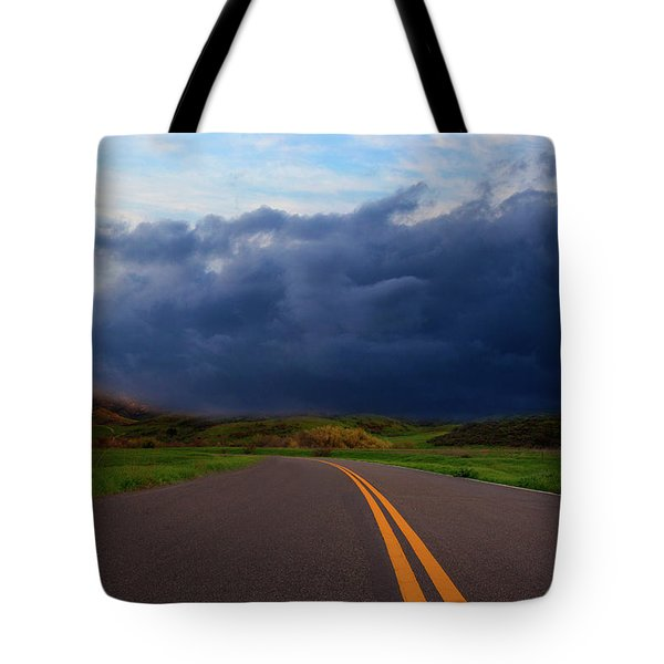 Tote Bag featuring the photograph The Road by John Rodrigues