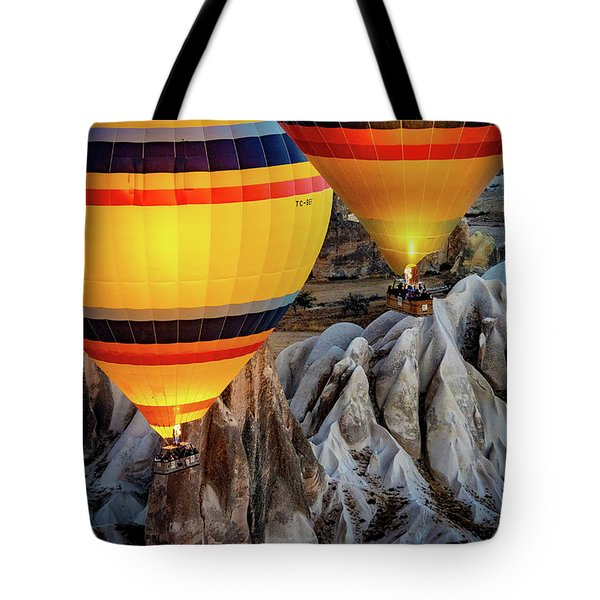 Tote Bag featuring the photograph The Yellow Balloons by Francisco Gomez