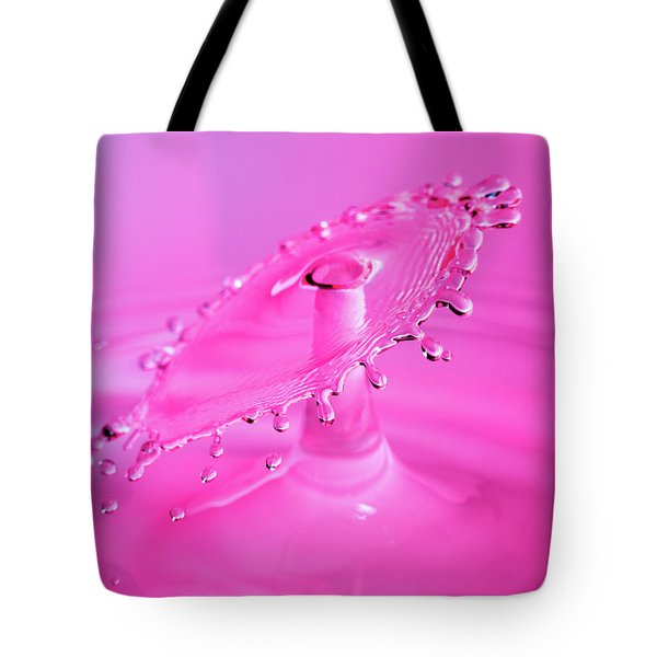 Tote Bag featuring the photograph Vivid Pink Water Drop Collision by SR Green