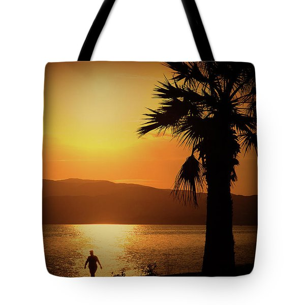 Tote Bag featuring the photograph Walking Down The Beach by Milena Ilieva
