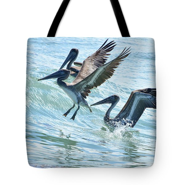 Wave Hopping Pelicans Tote Bag