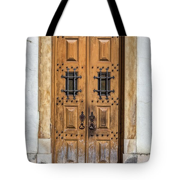 Tote Bag featuring the photograph Weathered Brown Door Of Portugal by David Letts
