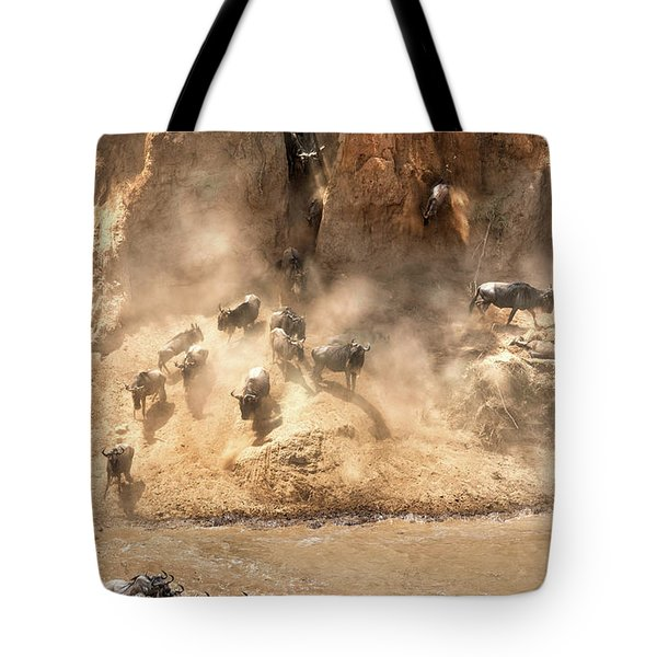 Wildebeest Jump From The Banks Of The Mara  Tote Bag