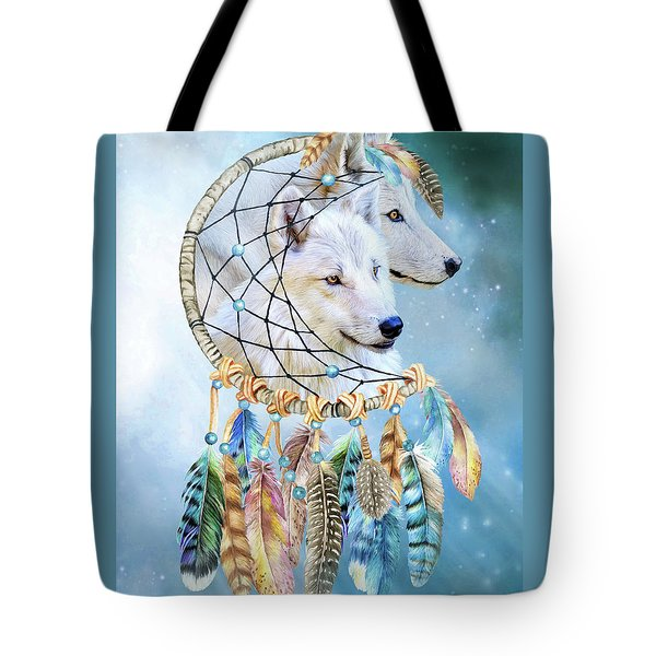 Tote Bag featuring the mixed media Wolf Dreams by Carol Cavalaris