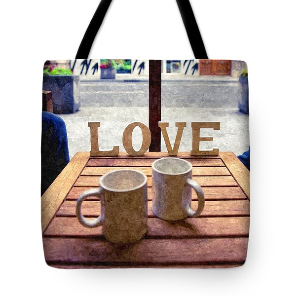Word Love Next To Two Cups Of Coffee On A Table In A Cafeteria,  Tote Bag