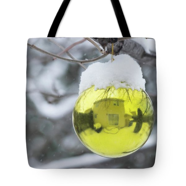 Tote Bag featuring the photograph Yellow Christmas Ball Outside, Covered By Snow And House Reflect by Cristina Stefan
