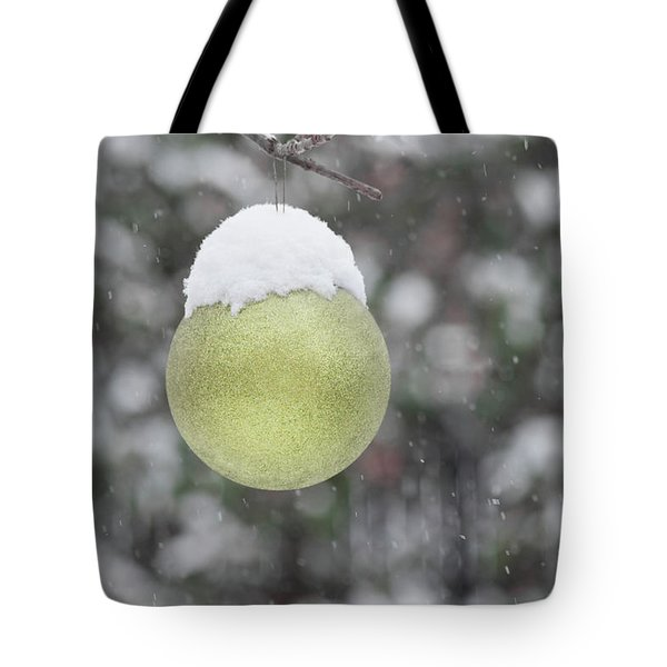 Tote Bag featuring the photograph Yellow Christmas Ball Outside, Covered By Snow. Outside Snowy Wi by Cristina Stefan